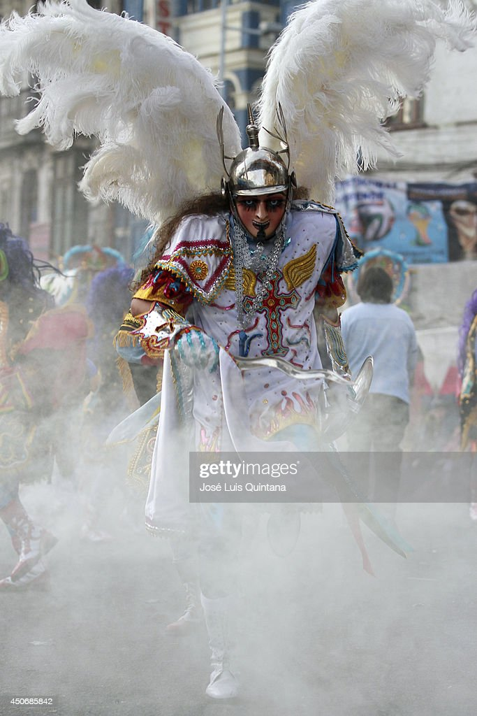 Costumed participants dance during the religious festival of Jesus del Gran Poder on June 15, 2014 in La Paz, Bolivia. About thirty thousand people attended the event, which is a traditional folk celebration in the country.