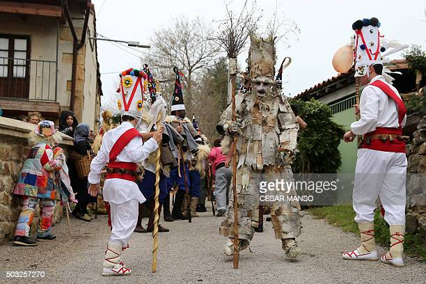 Costumed participants parade during celebrations of 'La Vijanera' carnival in Silio in the northern Spanish province of Cantabria on January 3 2016...