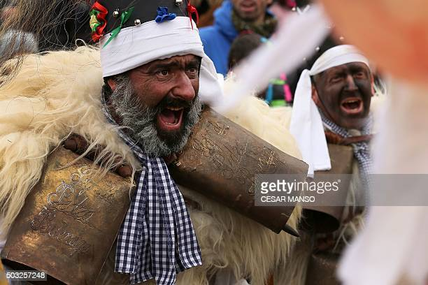 Costumed participants perform during celebrations of 'La Vijanera' carnival in Silio in the northern Spanish province of Cantabria on January 3 2016...