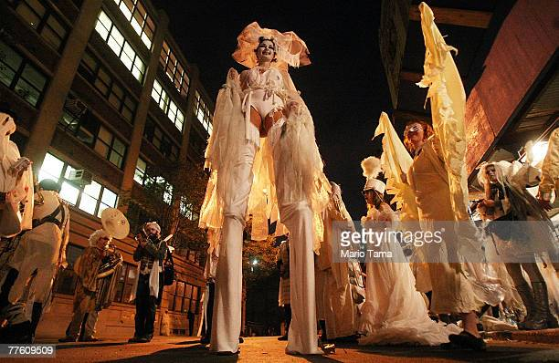 Costumed participants wait to march in the annual Village Halloween Parade October 31 2007 in New York City Approximately 2 million visitors attend...
