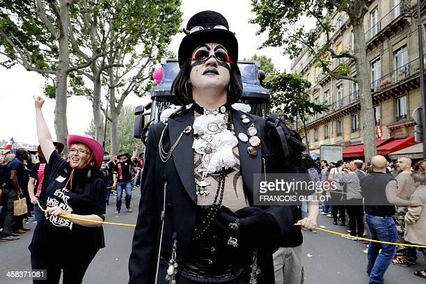 Costumed participants walk past during the 'Gay Pride' parade in Paris on July 2 2016 / AFP / FRANCOIS GUILLOT