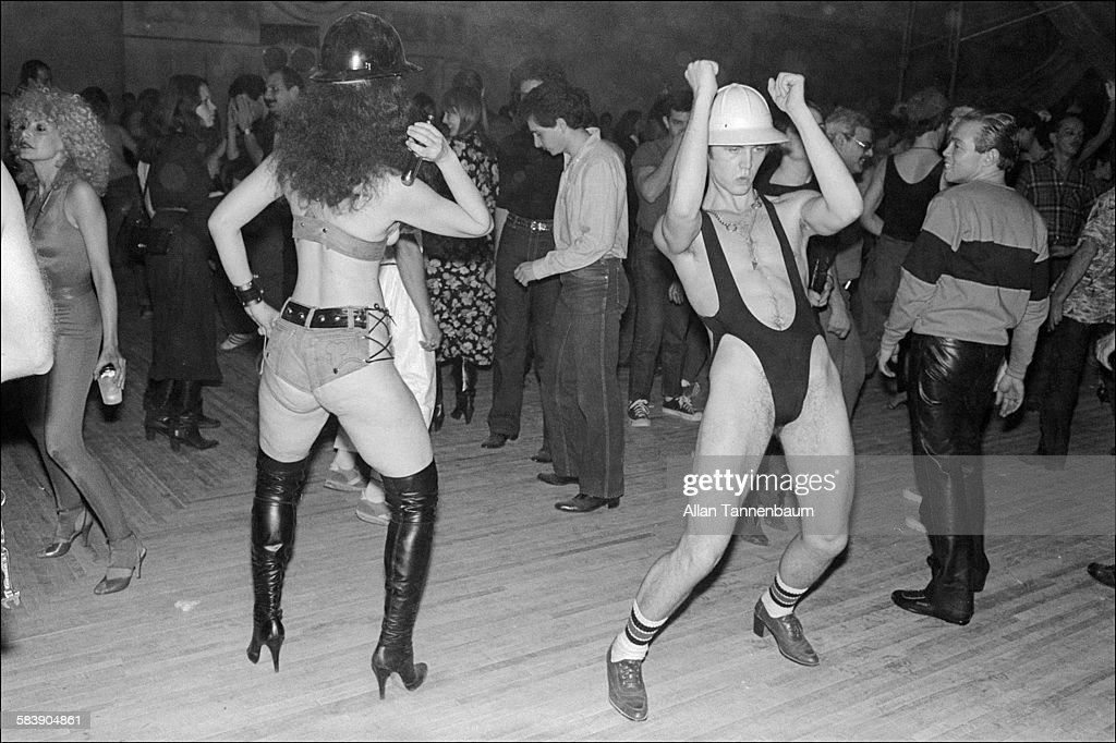 Costumed party goers dance during a Construction Party at Bonds' in Times Square, New York, New York, April 3, 1980.