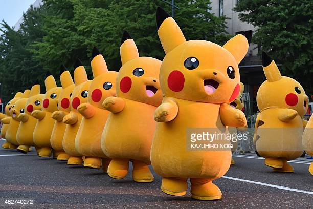 Costumed performers as Pikachu the popular animation Pokemon series character perform at the Yokohama Dance Parade in Yokohama on August 2 2015 The...