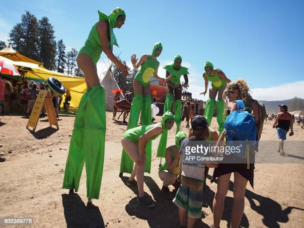 Costumed performers greet children and their parents at the familyfriendly Oregon Eclipse Festival August 18 at Big Summit Prairie ranch in Oregon's...