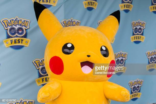 A costumed Pikachu character poses with attendees during the Pokemon GO Fest at Grant Park on July 22 2017 in Chicago Illinois