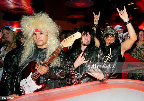 Costumed revelers attend a Halloween party at the Tangerine Lounge Nightclub at the Treasure Island Hotel Casino October 31 2005 in Las Vegas Nevada