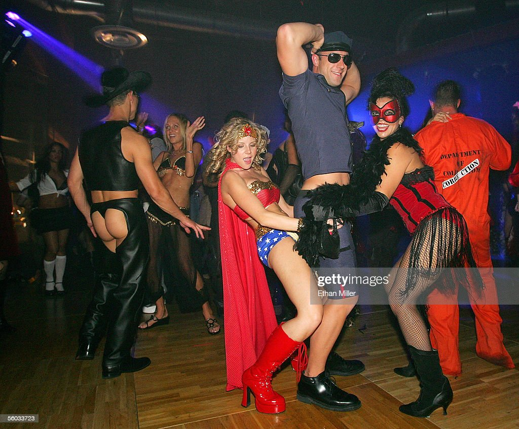 Costumed revelers dance during the 10th annual Fetish & Fantasy Halloween Ball at the Las Vegas Sports Center on October 29, 2005 in Las Vegas, Nevada.