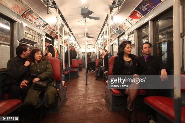 Costumed revelers ride an antique subway train during a 'Vintage Tea Party' hosted by Levy's Unique New York tour group December 13 2009 in New York...