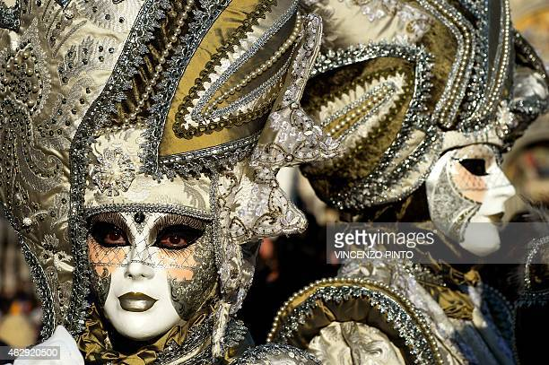 A costumed reveller poses in St Mark's square during the carnival on February 7 2015 in Venice The 2015 edition of the Venice carnival is untitled...