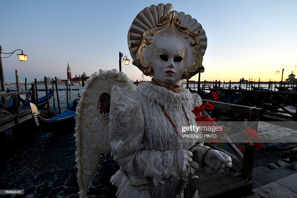 A costumed reveller poses near St Mark's square during the carnival on February 3, 2013 in Venice. The 2013 edition of the Venice carnival is untitled ' Live in Colour' and runs from January 26 to February 12.