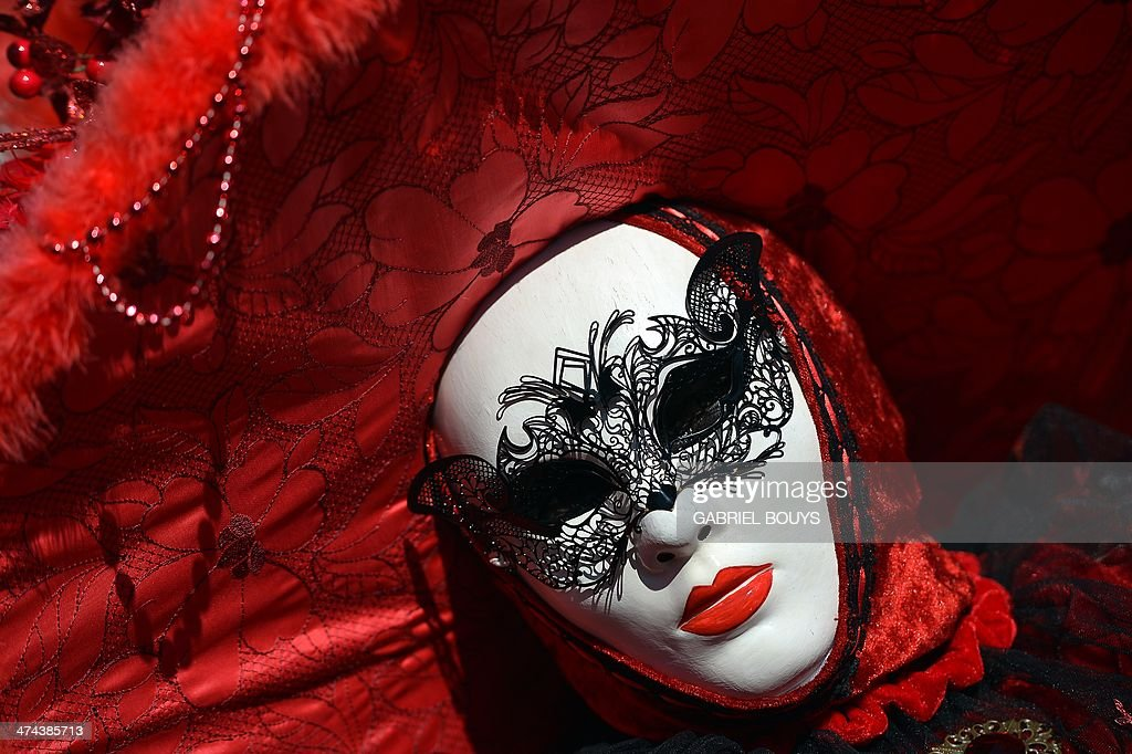 A costumed reveller poses near St Mark's square during the carnival on February 23 2014 in Venice The 2014 edition of the Venice carnival is untitled...