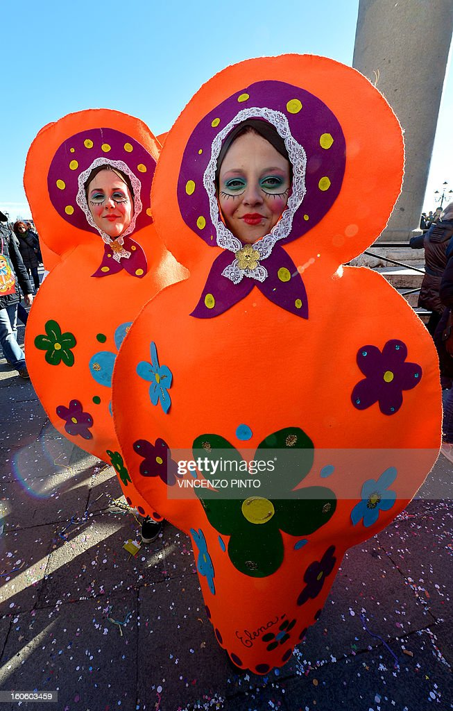 Costumed revellers pose at St Mark's square during the carnival on February 3, 2013 in Venice. The 2013 edition of the Venice carnival is untitled ' Live in Colour' and runs from January 26 to February 12.