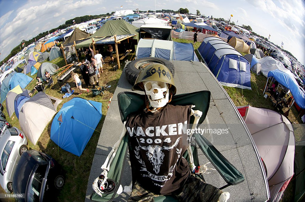A costumed skeleton sits on the roof of a camper during the 24th heavy metal Wacken Open Air (WOA) Festival 2013 in Wacken, northern Germany on August 1, 2013. With some 80,000 festival visitors it attracts all kinds of metal music fans, such as fans of black metal, death metal, power metal, thrash metal, gothic metal, folk metal and even metalcore, nu metal and hard rock from around the world.