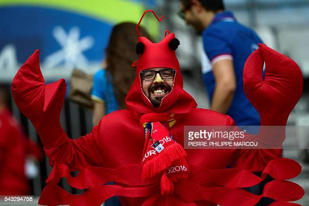 A costumed Spain supporter poses ahead the Euro 2016 round of 16 football match between Italy and Spain at the Stade de France stadium in SaintDenis...