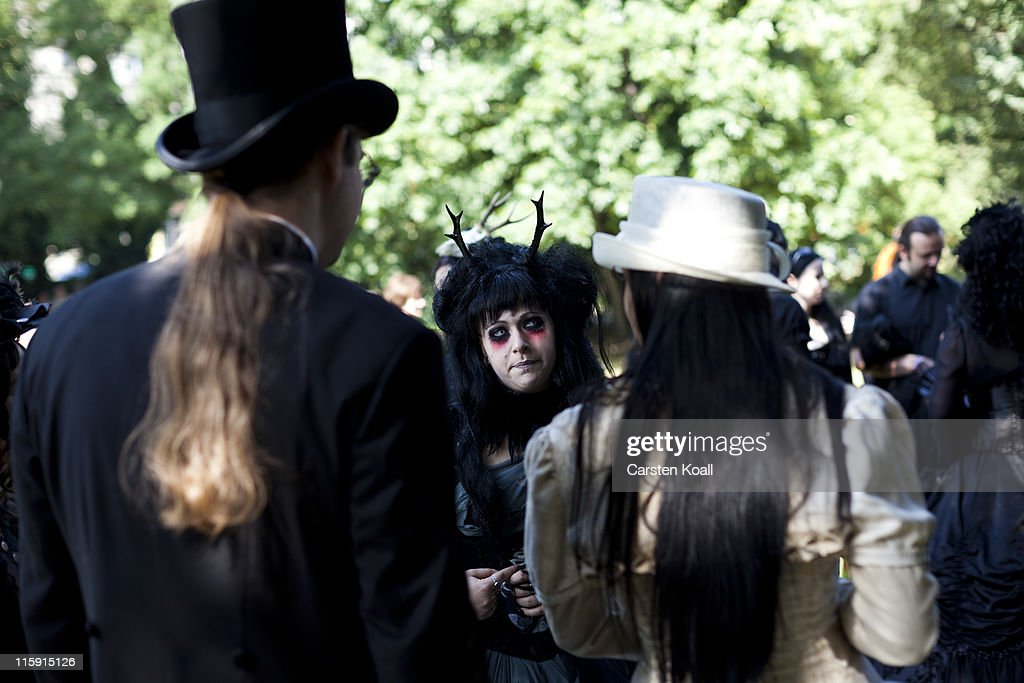 Costumed visitors stay togehter in a park during the annual Wave Gotik music festival on June 11, 2011 in Leipzig, Germany. The festival began in the 1990s and has since grown into one of the biggest gatherings of Goth scene followers in Europe with around 20,000 participants. Many of those attending wear elaborate outfits and make-up for which they require hours of painstaking preparation and that also show a departure from the traditional black of the Goth scene. Punk remains a strong influence in today«s Goth style as witnessed in Leipzig, but newer trends, with names like Cybergoth and Steampunk, have emerged that blend bold colors, Victorian fashion elegance and 19th and 20th century factory accessories into a look reminiscent of a mutated Venetian carnival. The five-day festival includes performances by around 200 bands.