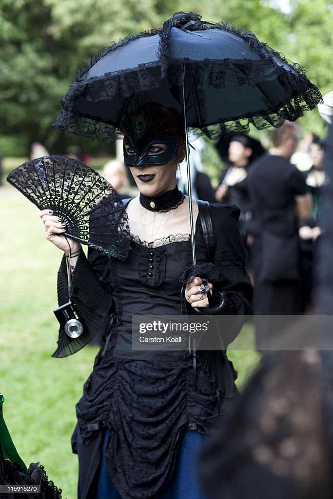 A costumed woman fans in a park during the annual Wave Gotik music festival on June 11, 2011 in Leipzig, Germany. The festival began in the 1990s and has since grown into one of the biggest gatherings of Goth scene followers in Europe with around 20,000 participants. Many of those attending wear elaborate outfits and make-up for which they require hours of painstaking preparation and that also show a departure from the traditional black of the Goth scene. Punk remains a strong influence in today«s Goth style as witnessed in Leipzig, but newer trends, with names like Cybergoth and Steampunk, have emerged that blend bold colors, Victorian fashion elegance and 19th and 20th century factory accessories into a look reminiscent of a mutated Venetian carnival. The five-day festival includes performances by around 200 bands.