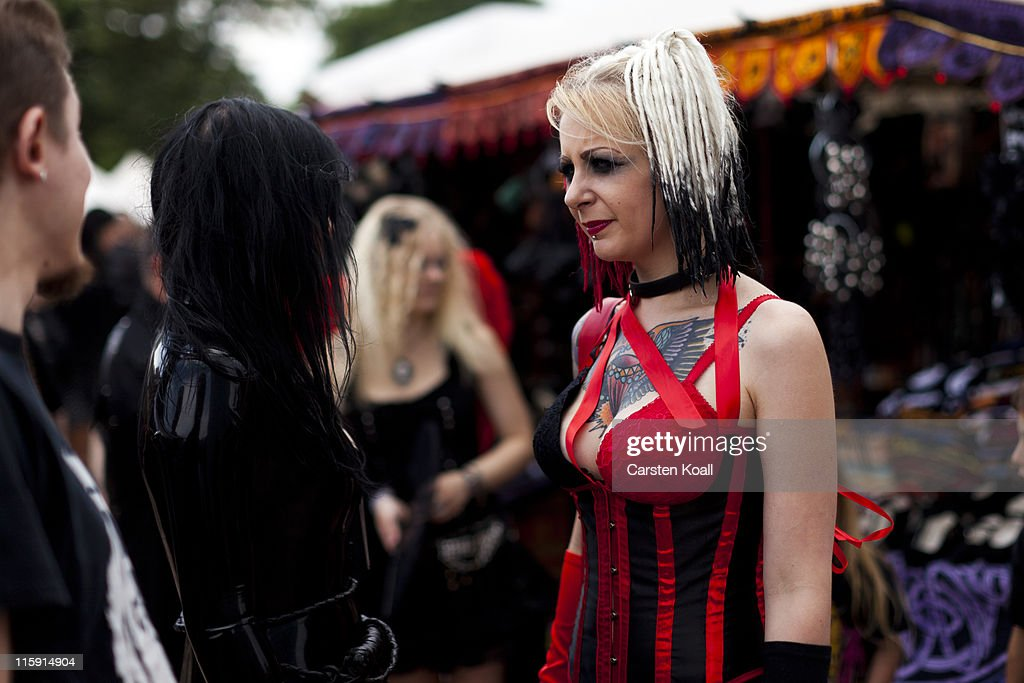 A costumed woman stands on the street between venues during the annual Wave Gotik music festival on June 11, 2011 in Leipzig, Germany. The festival began in the 1990s and has since grown into one of the biggest gatherings of Goth scene followers in Europe with around 20,000 participants. Many of those attending wear elaborate outfits and make-up for which they require hours of painstaking preparation and that also show a departure from the traditional black of the Goth scene. Punk remains a strong influence in todays Goth style as witnessed in Leipzig, but newer trends, with names like Cybergoth and Steampunk, have emerged that blend bold colors, Victorian fashion elegance and 19th and 20th century factory accessories into a look reminiscent of a mutated Venetian carnival. The five-day festival includes performances by around 200 bands.