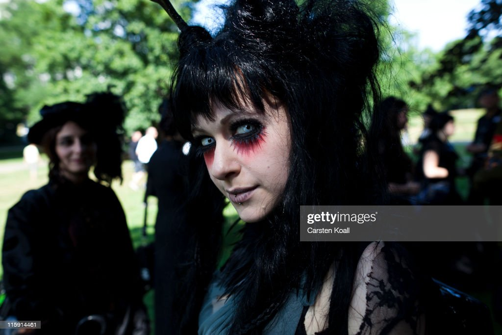 A costumed woman stays in a park during the annual Wave Gotik music festival on June 11, 2011 in Leipzig, Germany. The festival began in the 1990s and has since grown into one of the biggest gatherings of Goth scene followers in Europe with around 20,000 participants. Many of those attending wear elaborate outfits and make-up for which they require hours of painstaking preparation and that also show a departure from the traditional black of the Goth scene. Punk remains a strong influence in today«s Goth style as witnessed in Leipzig, but newer trends, with names like Cybergoth and Steampunk, have emerged that blend bold colors, Victorian fashion elegance and 19th and 20th century factory accessories into a look reminiscent of a mutated Venetian carnival. The five-day festival includes performances by around 200 bands.