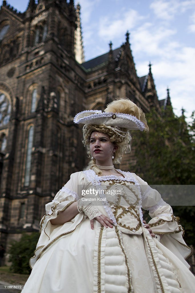 A costumed woman stays in front of a church after a classic concert during the annual Wave Gotik music festival on June 11, 2011 in Leipzig, Germany. The festival began in the 1990s and has since grown into one of the biggest gatherings of Goth scene followers in Europe with around 20,000 participants. Many of those attending wear elaborate outfits and make-up for which they require hours of painstaking preparation and that also show a departure from the traditional black of the Goth scene. Punk remains a strong influence in today's Goth style as witnessed in Leipzig, but newer trends, with names like Cybergoth and Steampunk, have emerged that blend bold colors, Victorian fashion elegance and 19th and 20th century factory accessories into a look reminiscent of a mutated Venetian carnival. The five-day festival includes performances by around 200 bands.
