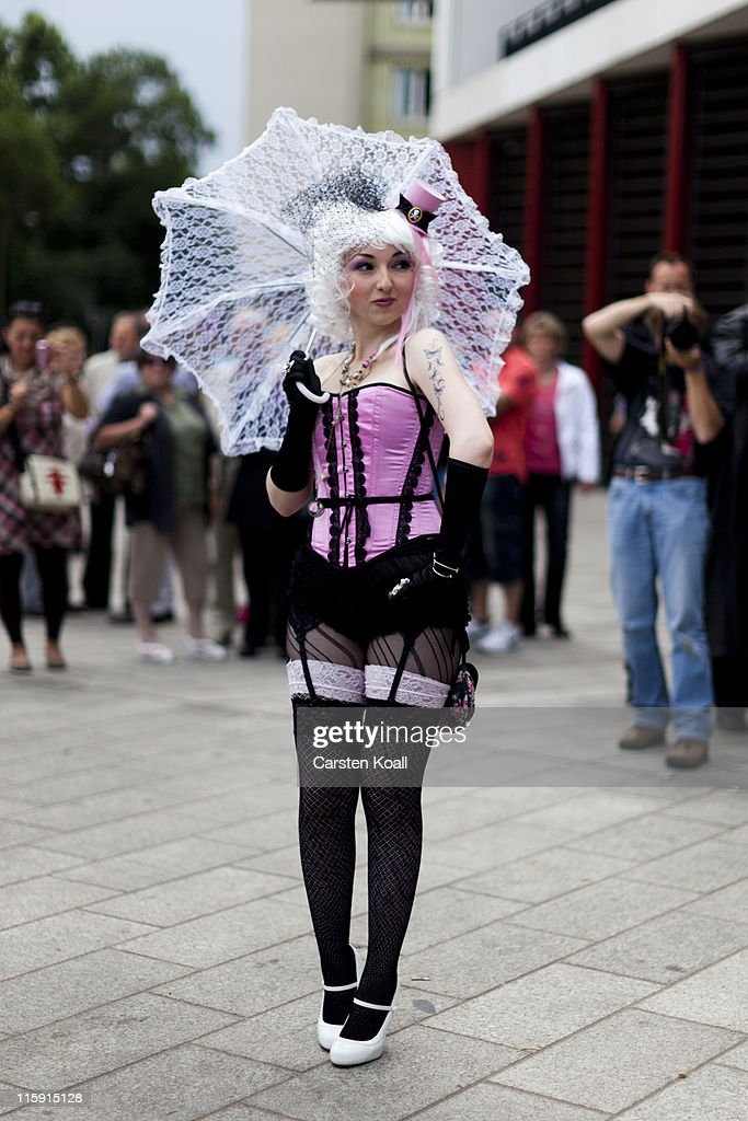 A costumed woman walks the streets between venues during the annual Wave Gotik music festival on June 11, 2011 in Leipzig, Germany. The festival began in the 1990s and has since grown into one of the biggest gatherings of Goth scene followers in Europe with around 20,000 participants. Many of those attending wear elaborate outfits and make-up for which they require hours of painstaking preparation and that also show a departure from the traditional black of the Goth scene. Punk remains a strong influence in today's Goth style as witnessed in Leipzig, but newer trends, with names like Cybergoth and Steampunk, have emerged that blend bold colors, Victorian fashion elegance and 19th and 20th century factory accessories into a look reminiscent of a mutated Venetian carnival. The five-day festival includes performances by around 200 bands.