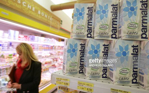 A costumer passes in front of a section with Parmalat products at a supermarket in Rome 05 October 2005 Dairy giant Parmalat will return to the...
