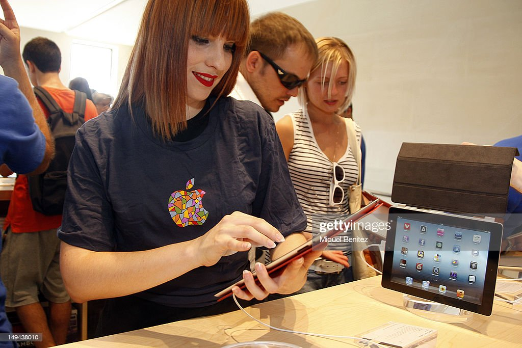A costumer plays with an iPad during the opening of Apple's New Barcelona Store in Passeig de Gracia on July 28, 2012 in Barcelona, Spain.