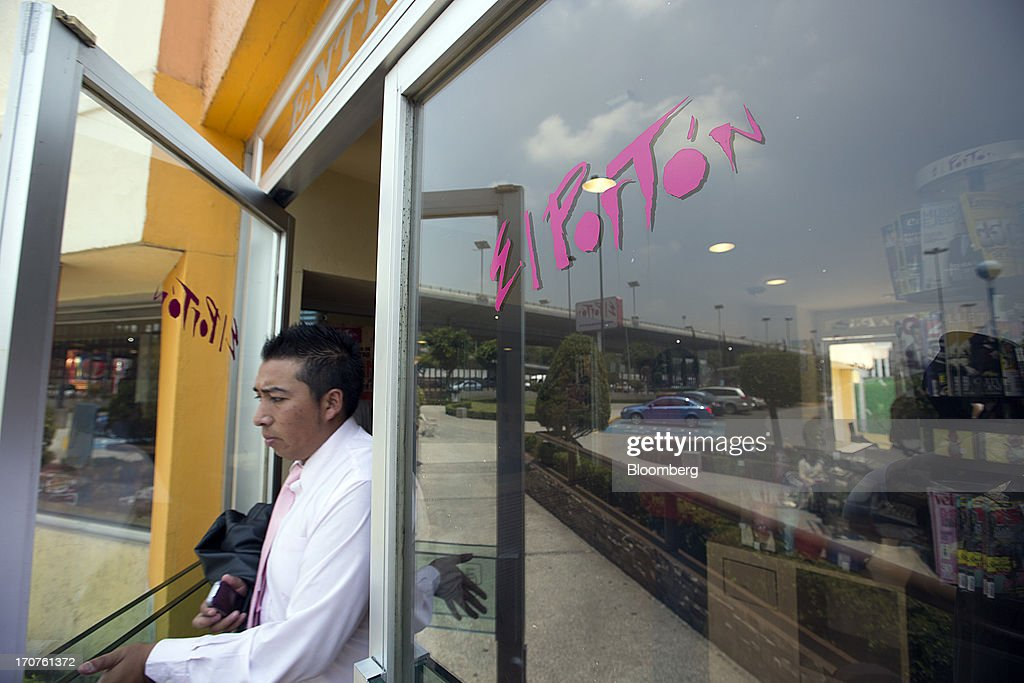 A costumer walks out of an El Porton restaurant in the El Toreo neighborhood of Mexico City, Mexico, on Monday, June 17, 2013. Wal-Mart de Mexico SAB de CV, known as Walmex, is considering offers to sell its restaurant division, which includes the Vips, El Porton, Ragazzi and La Finca brands. Photographer: Susana Gonzalez/Bloomberg via Getty Images