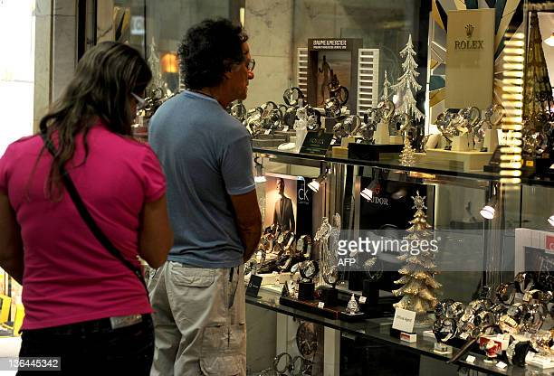 Costumers watch deluxe wristwatches at a shopping mall in Rio de Janeiro Brazil on January 5 2011 In 2010 11 million Brazilians traveled to the...