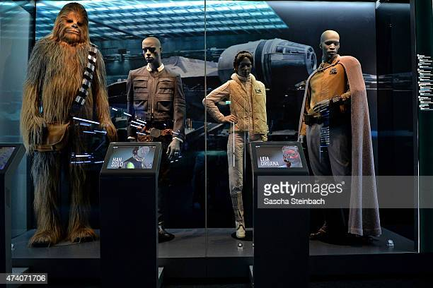 Costumes of Chewbacca the Wookie Han Solo Princess Leia Organa and Lando Calrissian are seen during the 'Star Wars Identities' Exhibtion Press...