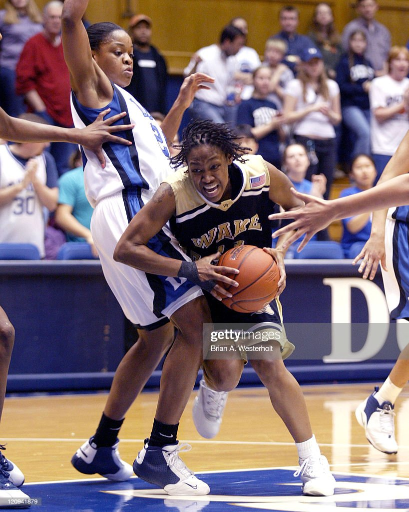 Cotelia Bond-Young (#13) atempts to drive the lane past Alana Beard (#20) during first half action, February 12, 2004.