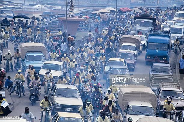 Heavy traffic beside the Dantopka market of Cotonou Dantopka is the largest market in west africa