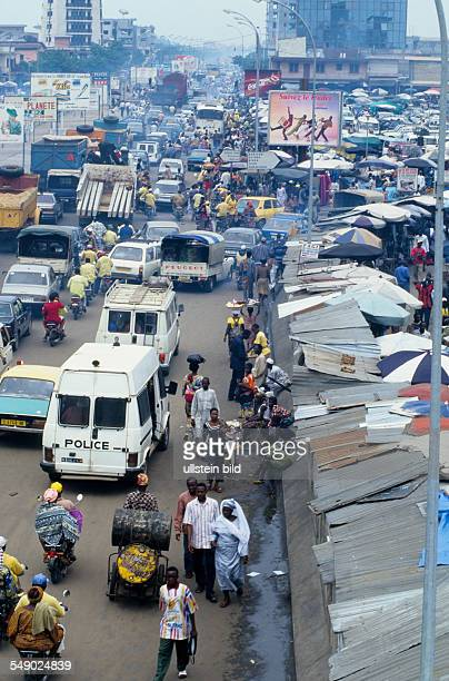 Heavy traffic beside the Dantopka market of Cotonou Dantopka is the largest market in west africa