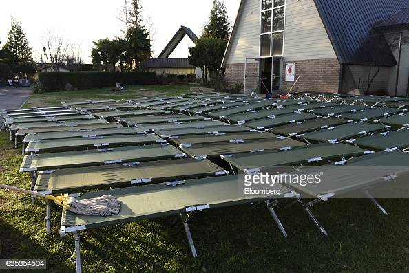 Cots are washed and set to dry at the Silver Dollar Fairgrounds evacuation center in Chico California US on Tuesday Feb 14 2017 State officials...
