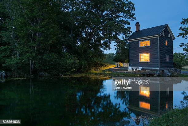 Cottage by a pond