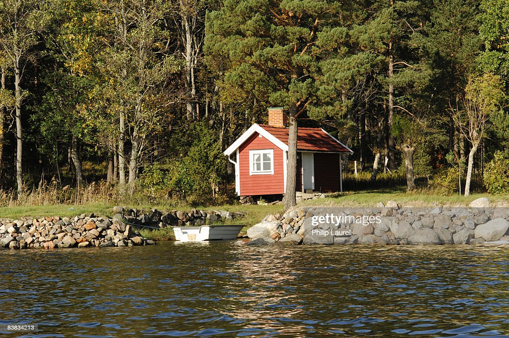 A cottage by the water Sweden. : Photo