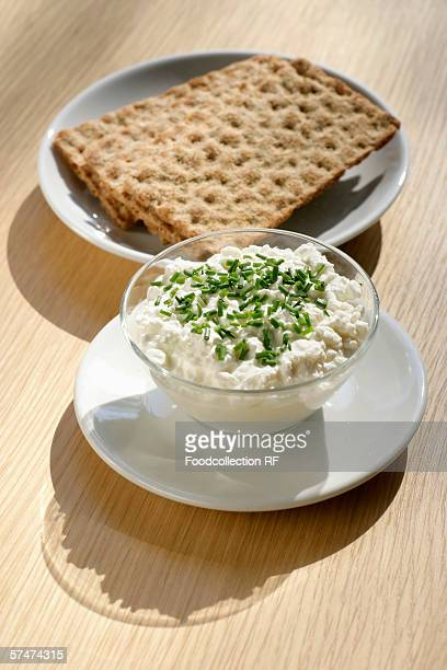 Cottage cheese in glass bowl with crispbread