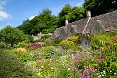 Cotswold cottage in the popular tourist destination of Bibury, Gloucestershire, England.