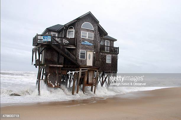 A cottage named Wave Breaker is hit by a tide amplified by a nor'easter hitting the Mirlo Beach section of Rodanthe NC on Hatteras Island on March 7...