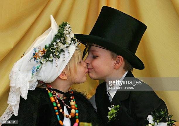 Fiance Axel kisses his bride Lea during the socalled Sorbian birds wedding 25 January 2007 at a kindergarten in Cottbus eastern Germany Children of...