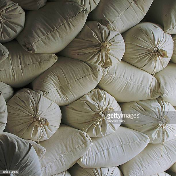 Cotton bags filled with flour