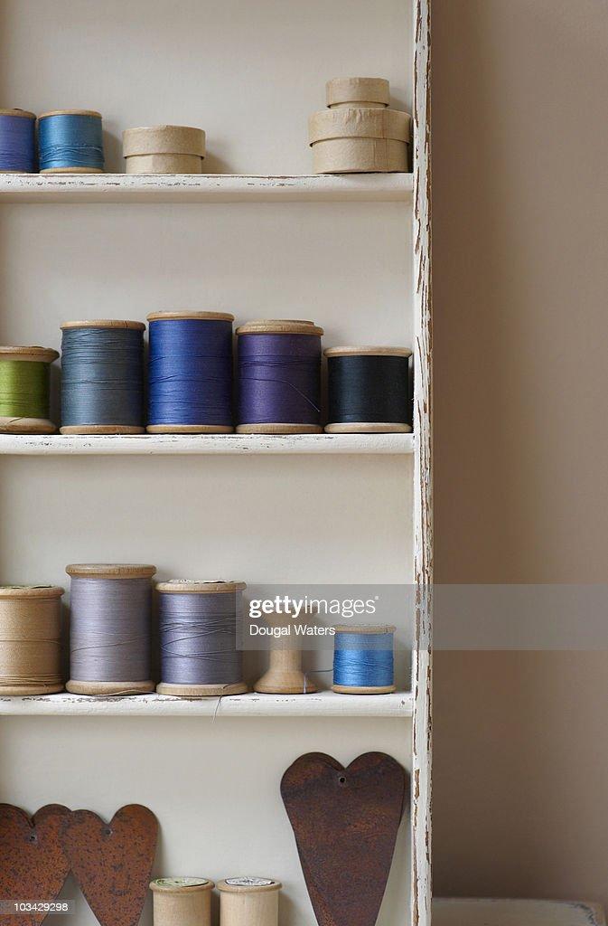 Cotton reels on shelves. : Stock Photo