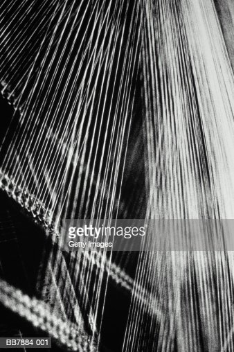 Cotton threads on loom, close-up (B&W)
