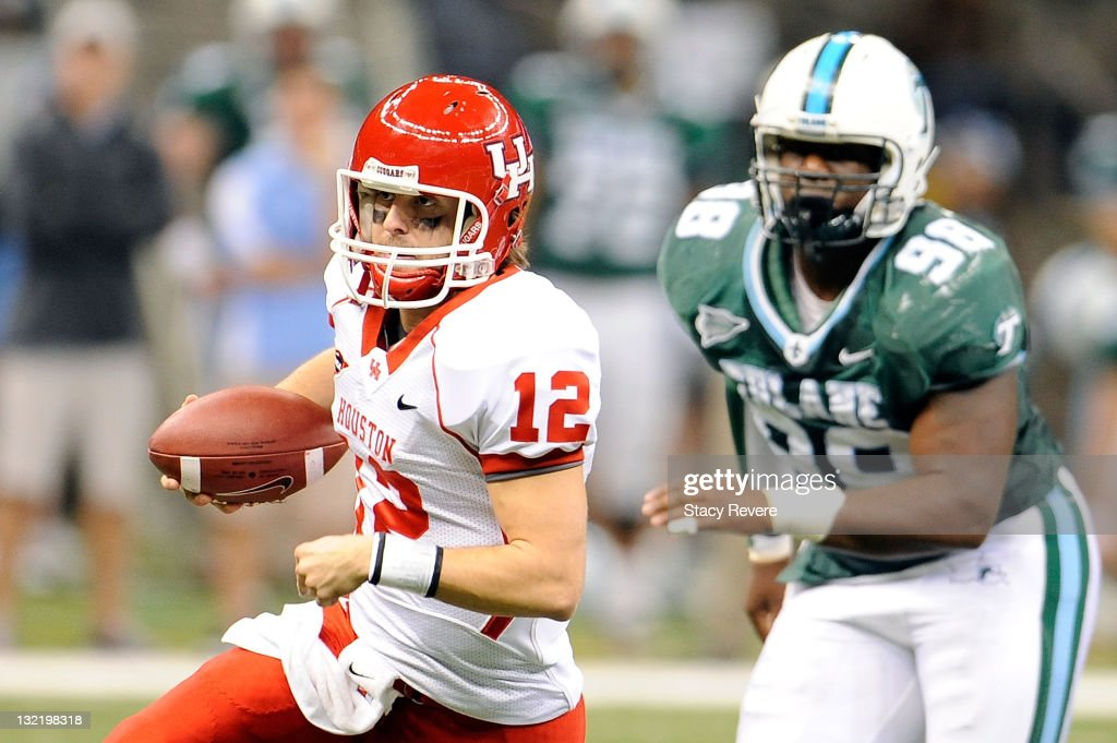 Cotton Turner #12 of the University of Houston Cougars is pursued by Cedric Wilson #98 of the Tulane Green Wave during a game being held at the Mercedes-Benz Superdome on November 10, 2011 in New Orleans, Louisiana.
