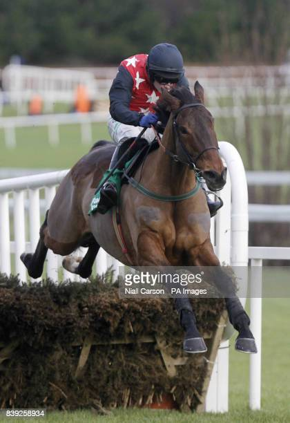 Cottrelsbooley ridden by Paul Townend jumps the last to win the Paddypowercom Android App Maiden Hurdle during day four of the Christmas Festival at...