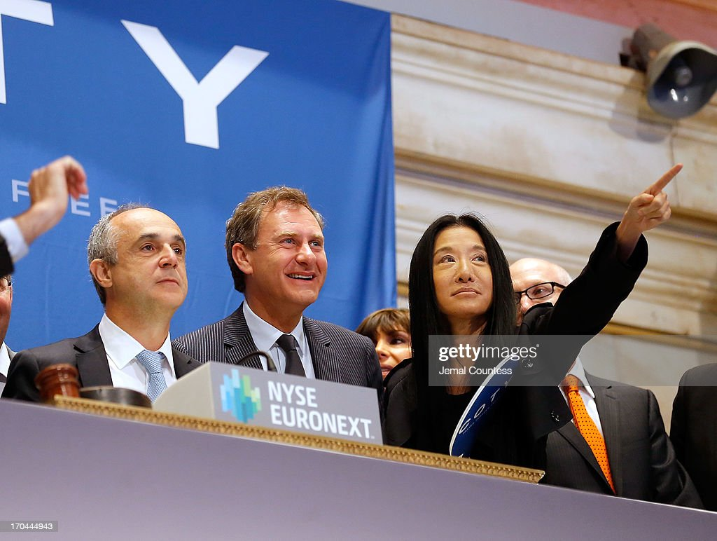 Coty CEO Michele Scannavini, President of Coty Prestige Jean Mortier and designer Vera Wang prior to the ringing of the opening bell at the New York Stock Exchange on June 13, 2013 in New York City. Global beauty company Coty made its public debut today.