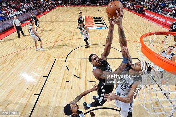 Coty Clarke of the Minnesota Timberwolves shoots the ball against Richard Solomon of the Phoenix Suns during the 2016 NBA Las Vegas Summer League...