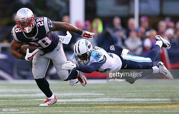 Coty Sensabaugh of the Tennessee Titans attempts to tackle James White of the New England Patriots during the first half at Gillette Stadium on...