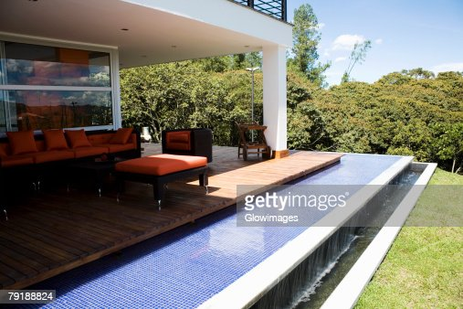 Couch and an armchair in a patio of a house : Foto de stock