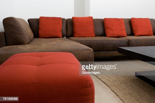 Couch and ottomans in a living room : Stock Photo