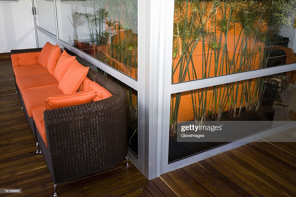 Couch in a patio of a house : Stock Photo